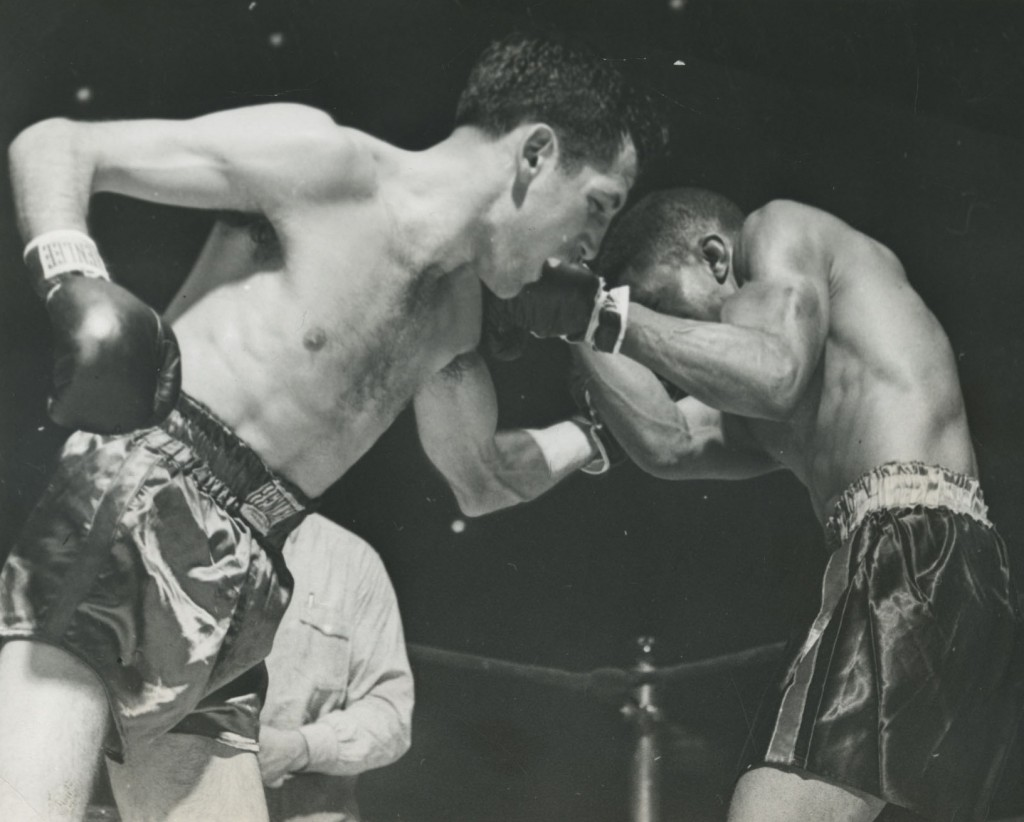 Bob Montgomery blocks a left hook by Chester Rico in the 1st round of Fight (113678) 8 January 1943.
